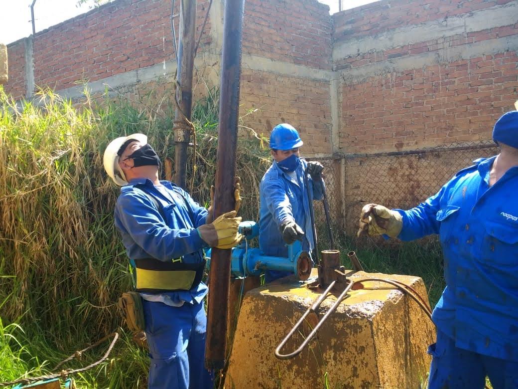 pozo trabajadores cubrebocas